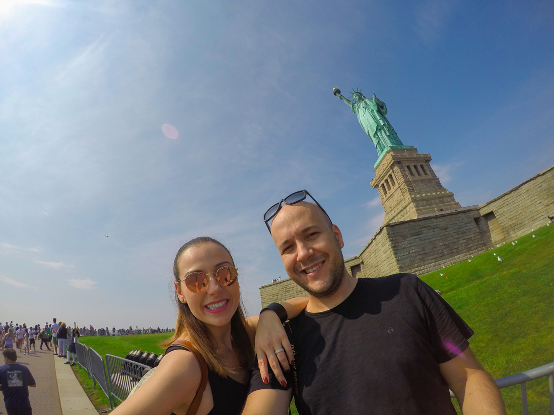 Tugce Anil selfie in front of statue of Liberty New York