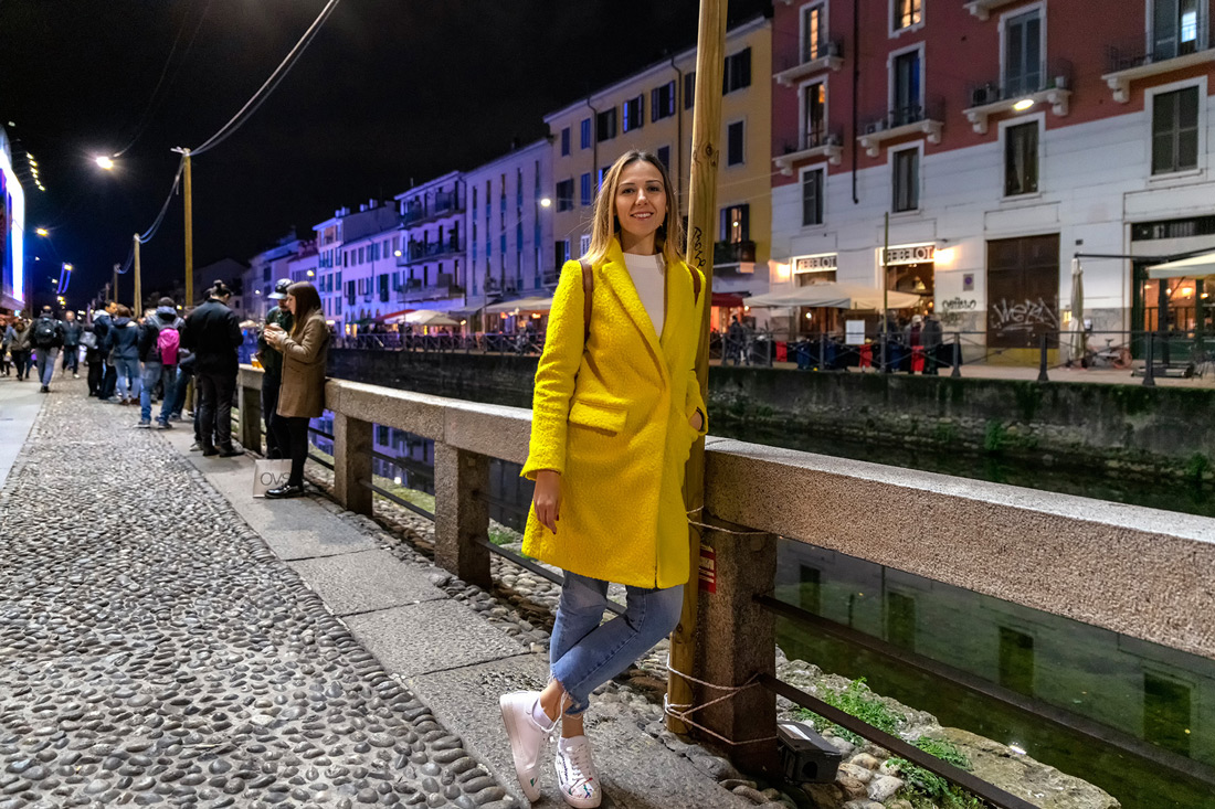 Tugce standing next to cannal in Navigli Milano