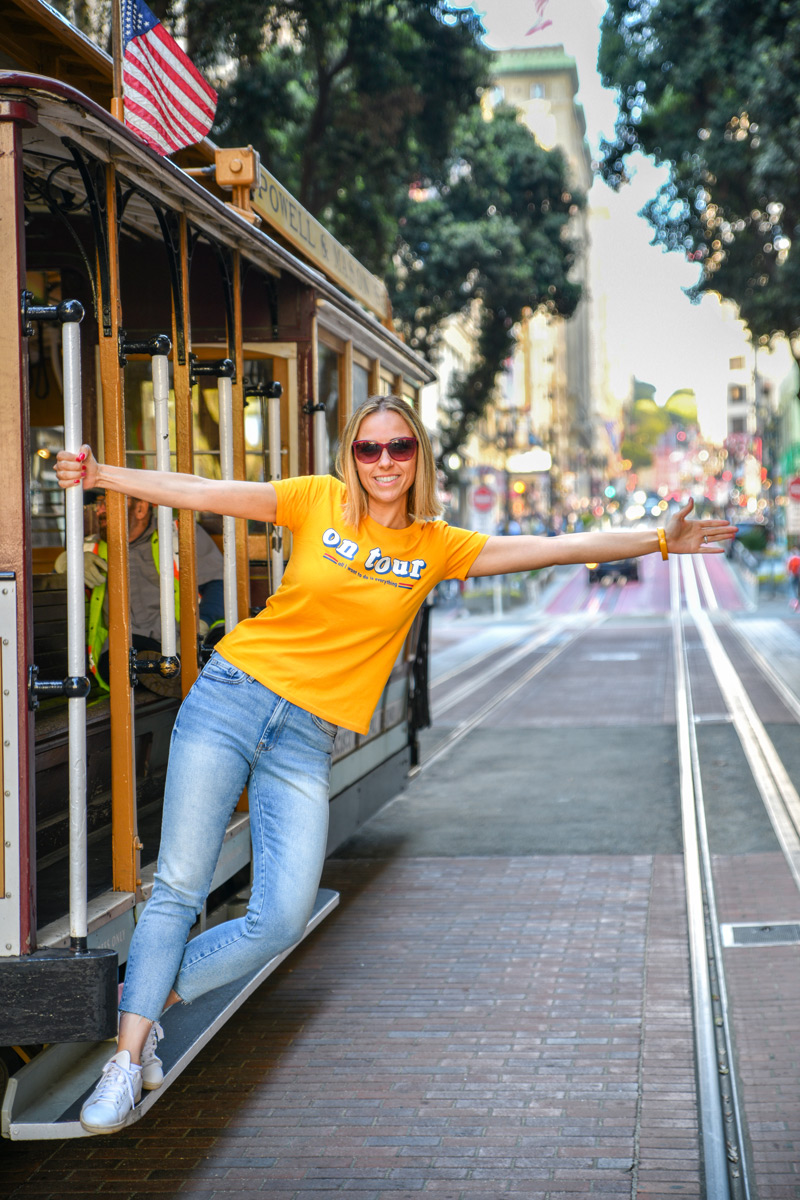 Tugce holding rail at San Francisco cable car