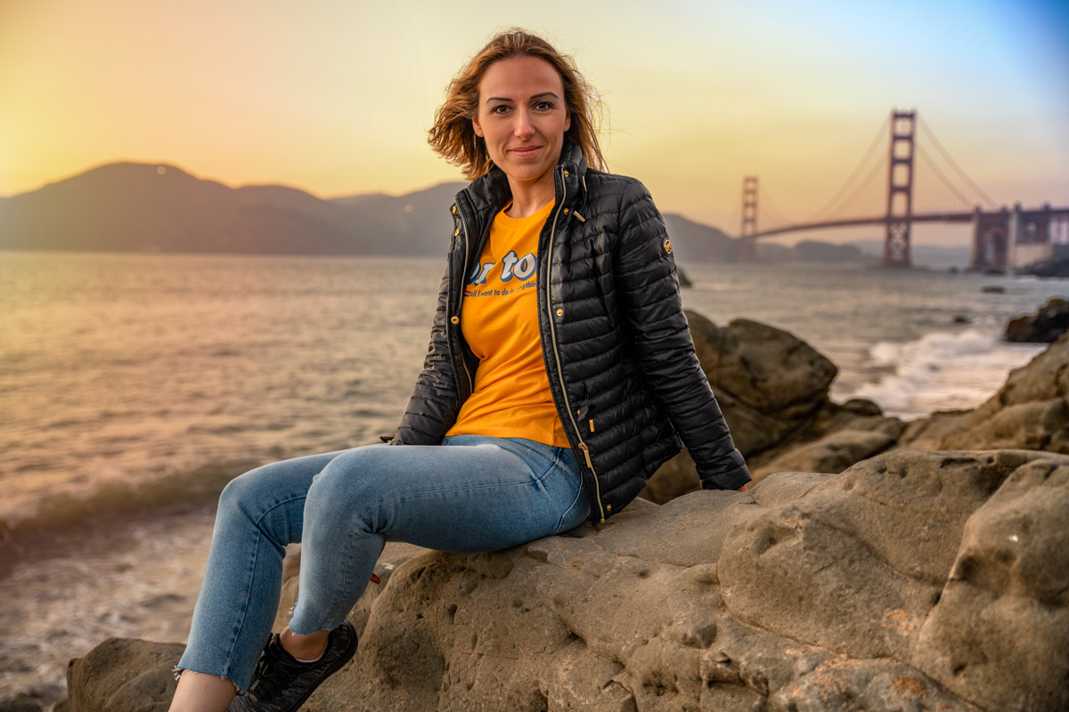 Tugce sitting on the rock San Francisco Golden Gate Bridger