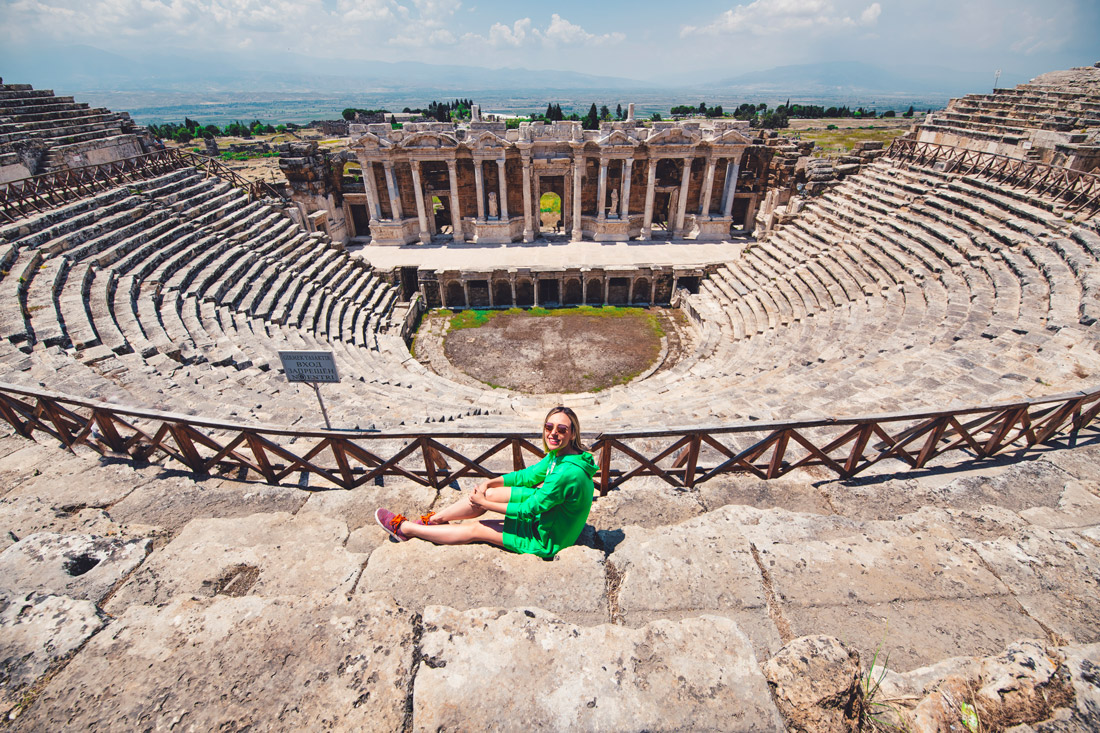 Tugce sitting on stair of amphitheater